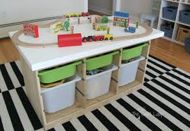 An Ikea Hack custom train and activity table with TONS of storage. This is  such