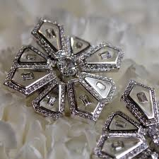 nikos koulis universe diamond and clear enamel earrings as seen at las vegas couture 2017