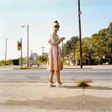 A dark suit that he tells me was made for him on savile row, highly polished black shoes, a white shirt and an untied bow tie around the neck. William Eggleston S Color Photos Were Shocking For Their Banality Cnn Style
