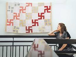 Swastika quilt donated to Greeley Museums is quirk of history ... & Erin Quinn, Greeley Museums manager, talks about a swastika quilt that a  Briggsdale family Adamdwight.com