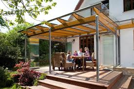 We love this veranda arrangement that combines natural wood and aluminium.  The elements in this project are also kept at bay with the sliding glass  panels.