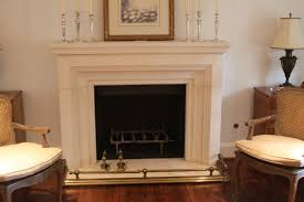 interior carving white fireplace mantel and black metal fire box added by silver steel candle