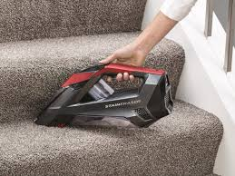 bis stain eraser being used to clean a carpeted stair