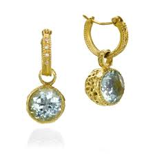 this 18 karat gold hoop earrings set with white diamonds and a complex aqua marine pendant is a unique design suitable for use with office wear and other