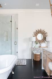 master bathroom white walls alabaster lamps plus mirrored console table decorating decor accessorizing white marble clawfoot tub blue ceiling 1 of 13 jpg