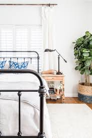 love the iron bed and raw wood nightstand looking to add a seasonal touch to