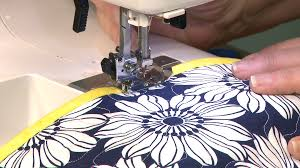 Working with PreQuilted Fabric | National Quilters Circle & Placemat Project shows you how to make a simple placemat with pre-quilted  fabric and straight-grain binding in a jiffy. Don't skip this segment just  because ... Adamdwight.com