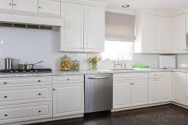 Off White Kitchen cabinets with White Subway Tiles
