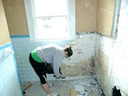replacing bathroom tile remove tiles removing how to replace installing walls grout ceramic repair cost