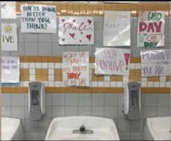 Good enough CA high school replaces bathroom mirrors with posters