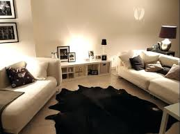cowhide rug living room black contemporary ideas layered cowhide rug