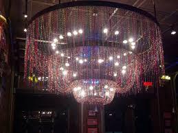 razoo s cajun cafe mardi gras bead chandelier in foyer at razzoo s