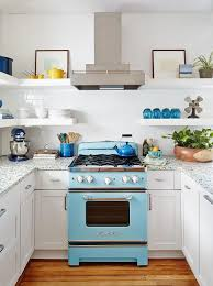 blue big chill stove with white floating shelves