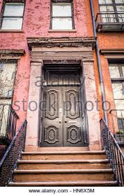 city apartment building entrance. subway entry new york · typical entrance door to a city apartment building residential home - stock photo t
