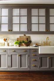 Nice brass traditional drawer pulls on a grey kitchen. Looking good! http:/