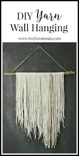diy yarn wall hanging this is so easy to make you might want to