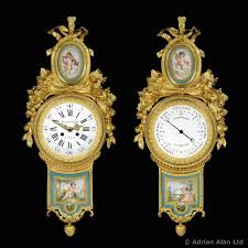 a gilt bronze wall clock and matching barometer with sèvres plaques