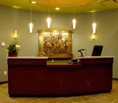 front office decorating ideas. Front Office Brown Varnished Wooden Reception Table Light Home E2 Decorating Ideas