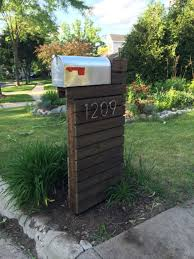 mailbox designs. Amazing Modern Mailbox Design With Silver Color Metal Box And Red Flag Brown Wooden Post Designs