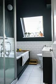 blend of light and dark elements in the scandinavian bathroom photography noah darnell