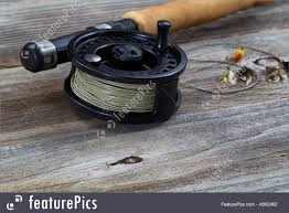 hunting and fishing close up of fly reel focus on front bottom of reel