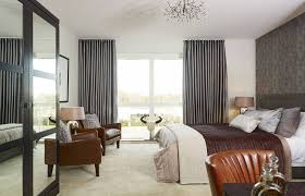 charming grey bedroom wallpaper art with black curtain and cozy brown single chair idea
