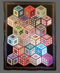 71 best Tumbling Blocks Quilts images on Pinterest | 3d quilts ... & Tumbling blocks quilt with stars by Bernice Enyeart. Photo by Skybridge  Studios Adamdwight.com