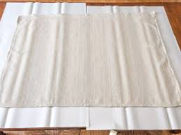 diy rug using a drop cloth and chalk paint and paper to protect surface
