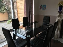 stunning glass dining table set with 6 faux leather chairs black fully folding