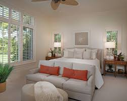 Mid-sized island style master carpeted bedroom photo in Miami with white  walls