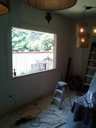 hole through siding is cut and window is ready to install