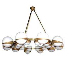 round globe chandelier with white glass on brass frame for