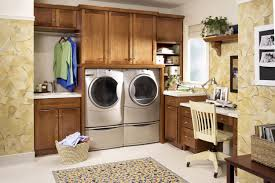 laundry room furniture. Awesome Wooden Laundry Room Cabinets And Glossy Grey Washing Machines Facing Oak Desk Furniture