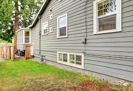 hardboard exterior cladding. boards or planks of cedar cladding are overlapped to create a look often known as \ hardboard exterior e