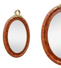 antique oval mirror with a pediment in gilded bronze painted wooden oval frame rosewood