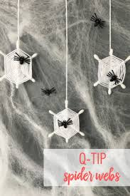 Add a spooky element to your home with these DIY Spider Webs. Grab a few  supplies from around the house  like Q-tips and yarn  to create the  simple craft.