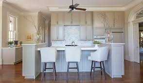 ceiling fan for kitchen. A Ceiling Fan Hangs Over Gray Kitchen Island With End Cabinets Topped White Marble Lined Leather Barstools. For G