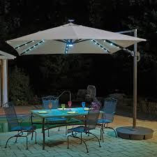 island umbrella santorini ii fiesta full sized 9 6 ft cantilever patio umbrella beige patio umbrellas best canada