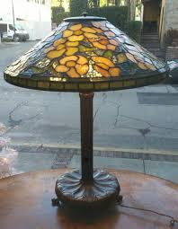 tiffany studios lamp library table leaded glass lamp alamanda shade stamped tiffany studios new york 1479 and artichoke bronze base stamped