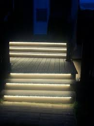 outdoor led lighting under stairs to light up the night warm white flexible strips were used to create this beautiful effect toe kick lights are easy to