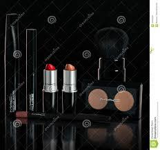 chisinau republic of moldova october 11 2016 set pany mac makeup lipstick mascara powder brush pencil on a black background photo