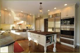 affordable kitchen furniture. White Painted Solid Wood Affordable Kitchen Cabinets Combined With Island Dark Wooden Table Furniture