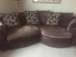brown corner sofa and swivel chair half leather half fabric