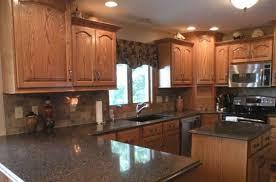well liked oak kitchen cabinets with dark countertops stkittsvilla com gh69