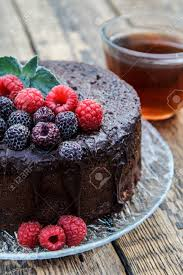 Homemade Chocolate Cake Decorated With Mint Leaves Black And