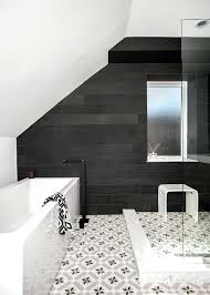 black and white bathroom floor black and white patterned tiles an open shower help to make