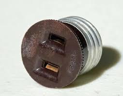 plug that s into a light socket socket plug used to convert a bulb socket to