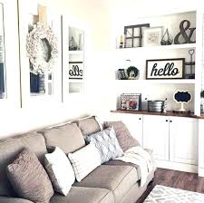 over the couch wall decor mirrors above with wreath open room up cream decorating ideas behind