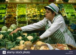 a s assistant sorting cauliflowers in the fruit and vegetable a s assistant sorting cauliflowers in the fruit and vegetable section of an asda supermarket in dewsbury yorkshire england