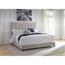B130-582 Ashley Furniture Dolante Eastern King Upholstered Bed - Beige